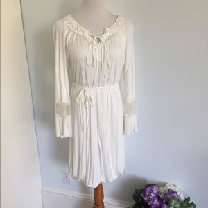 White dress by Poleci  bell sleeve